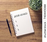 2018 goals list in notebook... | Shutterstock . vector #740445088