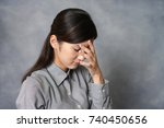 woman in depression | Shutterstock . vector #740450656