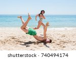 couple running on the beach ... | Shutterstock . vector #740494174