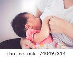 closeup on mother hand holding... | Shutterstock . vector #740495314