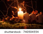 advent candles lit on a natural ... | Shutterstock . vector #740504554
