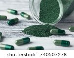 spirulina capsules with powder... | Shutterstock . vector #740507278