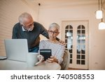 a senior couple looking very... | Shutterstock . vector #740508553