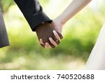 the hands of the newlyweds. the ... | Shutterstock . vector #740520688