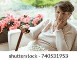 sad elder woman sitting on... | Shutterstock . vector #740531953
