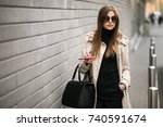 woman with phone | Shutterstock . vector #740591674