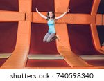 young woman sportsman jumping... | Shutterstock . vector #740598340