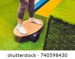 women on deck for balance board.... | Shutterstock . vector #740598430