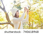 asian woman taking the picture   Shutterstock . vector #740618968
