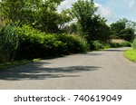curved road in park nature... | Shutterstock . vector #740619049