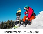 man snowboarder sitting on the... | Shutterstock . vector #740653600