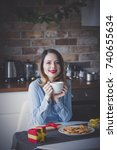beautiful young woman sitting...   Shutterstock . vector #740655634