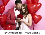 man giving roses and embracing... | Shutterstock . vector #740668558