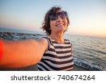 stylish attractive mature woman ... | Shutterstock . vector #740674264