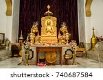 Small photo of October 13,2017. Varanasi,Utter Pradesh,India. Sitting Golden Buddha statue at a Buddhist temple at Mulagandhakuti vihara, Sarnath, Varanasi.