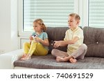 two happy children playing... | Shutterstock . vector #740691529