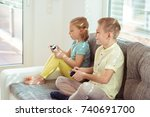 two happy children playing... | Shutterstock . vector #740691700
