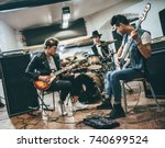 repetition of rock music band.... | Shutterstock . vector #740699524