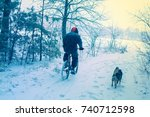 Man Ride Bicycle In Snowy...