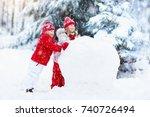 children build snowman. kids... | Shutterstock . vector #740726494