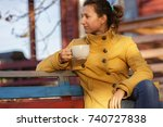 young woman is cold in autumn... | Shutterstock . vector #740727838