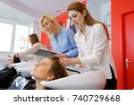 trainee hairdresser washing... | Shutterstock . vector #740729668