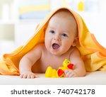 happy baby boy in towel after...   Shutterstock . vector #740742178