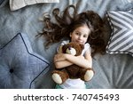 little girl is playing with a... | Shutterstock . vector #740745493