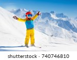 child skiing in the mountains....   Shutterstock . vector #740746810
