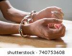 hand of man in handcuffs | Shutterstock . vector #740753608