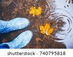 woman legs walking in puddle in ... | Shutterstock . vector #740795818