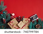 fir branch and gift box on red... | Shutterstock . vector #740799784