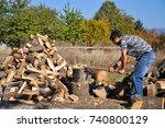 lumberjack chopping wood for...   Shutterstock . vector #740800129