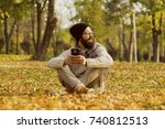 handsome man using mobile smart ... | Shutterstock . vector #740812513