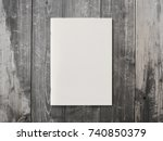 Stock photo blank magazine or brochure on brown wooden background front cover top view mockup concept for 740850379