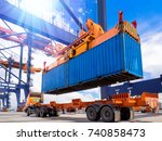 Industrial port crane lift up loading export containers box onboard from truck at port of Thailand,The port crane type