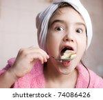 girl eating a cake | Shutterstock . vector #74086426
