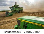 Small photo of Hradec Kralove, Czechia August 4, 2017: Modern John Deere combine harvester model S685i and tractor 6250R at the harvest of wheat near the town Hradec Kralove, Northern Czechia