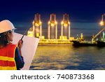 female site engineer with white ... | Shutterstock . vector #740873368