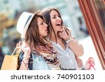 two young women walking and... | Shutterstock . vector #740901103