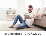 young smiling man checking... | Shutterstock . vector #740912110