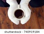 coffee mug in hands mittens... | Shutterstock . vector #740919184