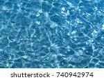 shining blue water ripple... | Shutterstock . vector #740942974