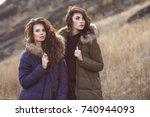 two beautiful woman in fashion... | Shutterstock . vector #740944093