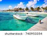 puerto morelos beach boats in... | Shutterstock . vector #740953354