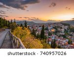 Scenic view of Kastoria town and the famous Orestiada lake in fall season against a cloudy sky. West Macedonia, Greece, Europe.