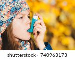 Small photo of Asthma patient girl inhaling medication for treating shortness of breath and wheezing in a park. Chronic disease control, allergy induced asthma remedy and allergy disease concept