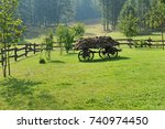 mountain landscape with hay... | Shutterstock . vector #740974450