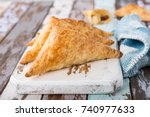 puff pastry triangles filled... | Shutterstock . vector #740977633