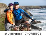 mature couple riding bikes | Shutterstock . vector #740985976
